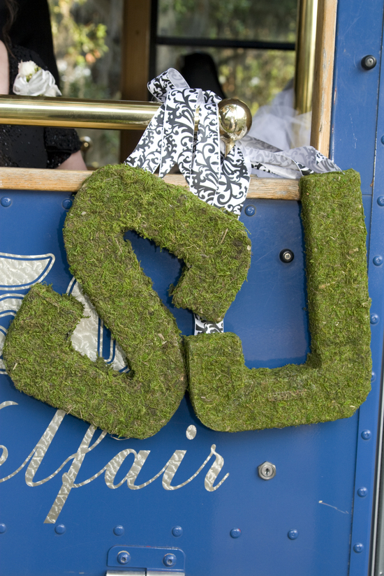 Mossy green wedding initials to decorate the ceremony or reception