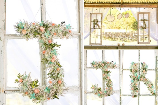 Romantic floral wedding initials in sage peach and ivory at elegant reception