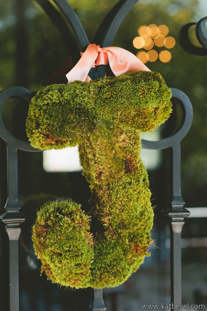 Moss-j-wedding-door-decor-with-peach-ribbon.full
