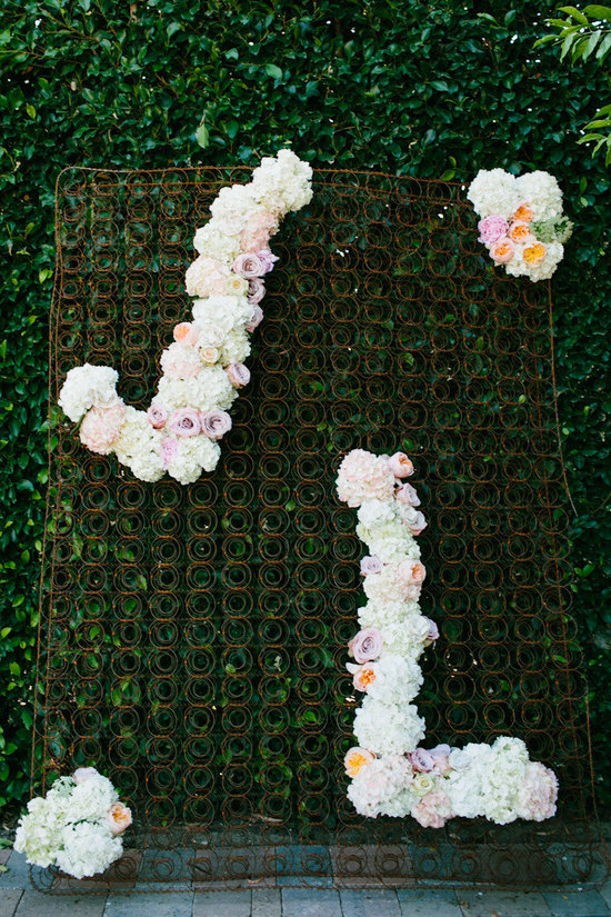 Wedding backdrop with romantic floral initials
