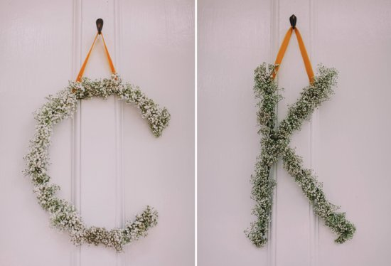Romantic babys breath wedding initials hang on ceremony door