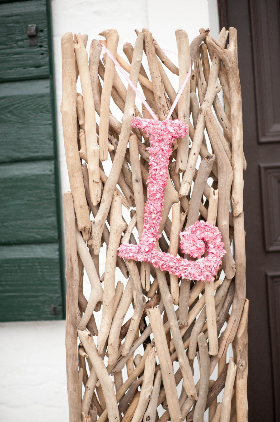 Pale-pink-wedding-flower-initials-hang-from-beachwood-backdrops.full