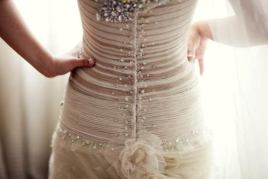Amazing corseted wedding dress with beading up the back