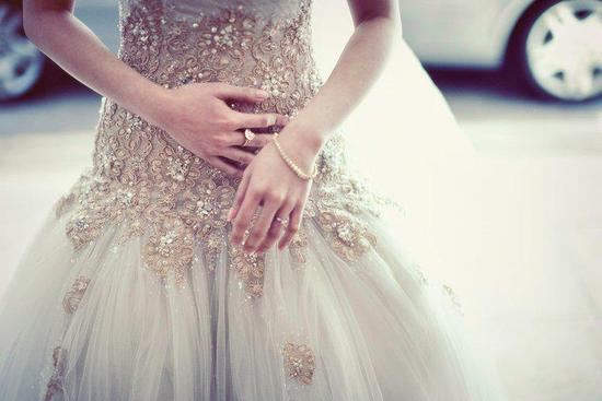 Champagne beaded tulle wedding dress with dropped waist