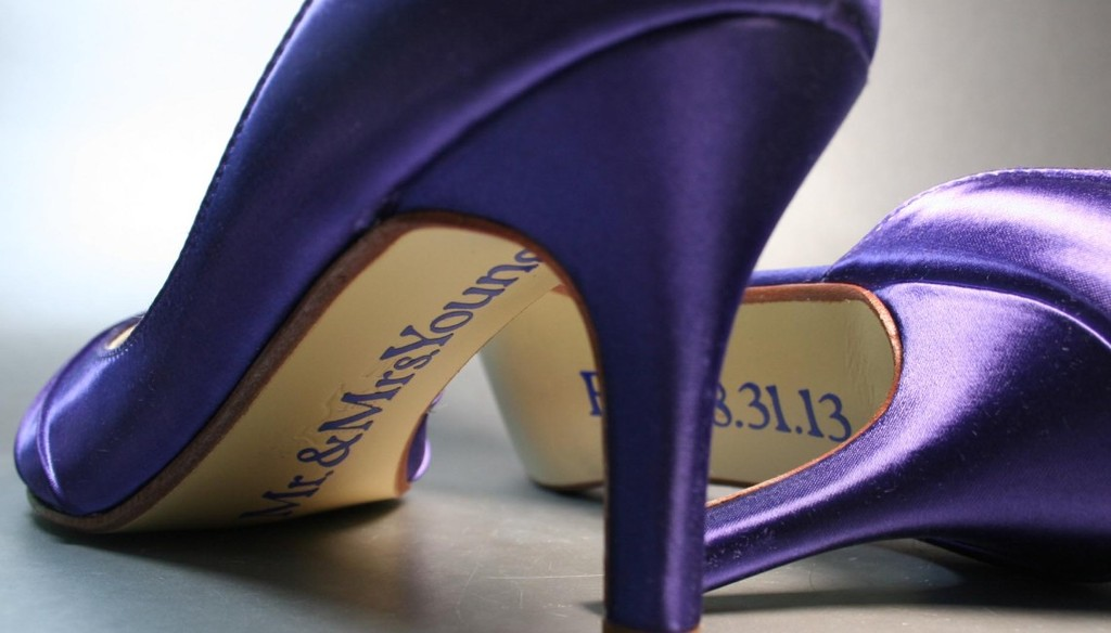 Purple satin wedding shoes with custom message on soles
