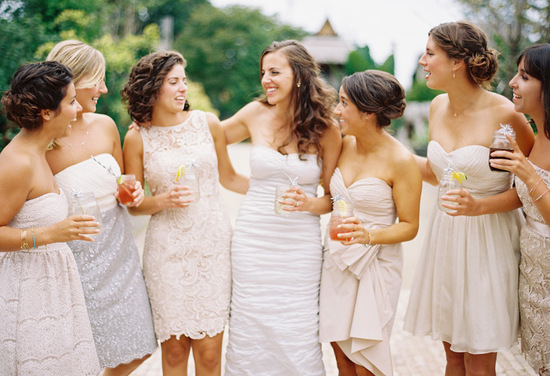 photo of Neutral mix and match bridesmaids for outdoor garden wedding