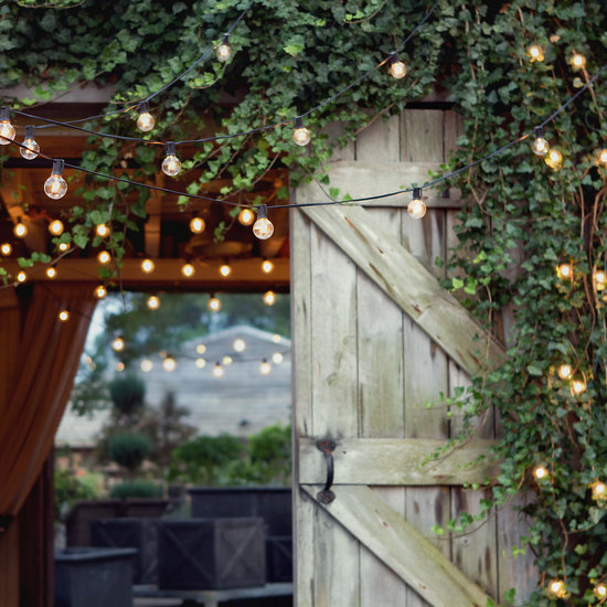 photo of festival lights for outdoor wedding reception