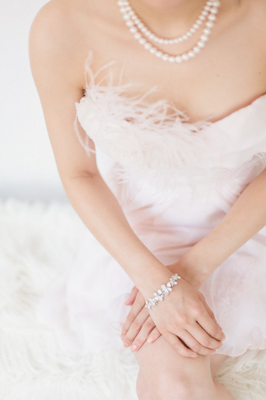 feather fringe on pale pink wedding dress