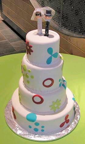Modern-white-stacked-round-wedding-cake-with-red-aqua-lime-green-details.full