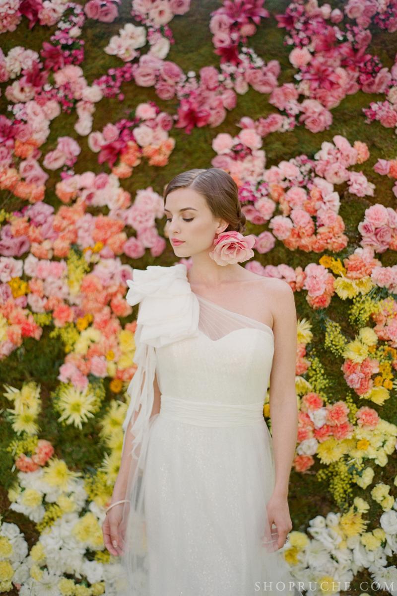 Enchanted-wedding-backdrop-of-yellow-orange-pink-blooms.full