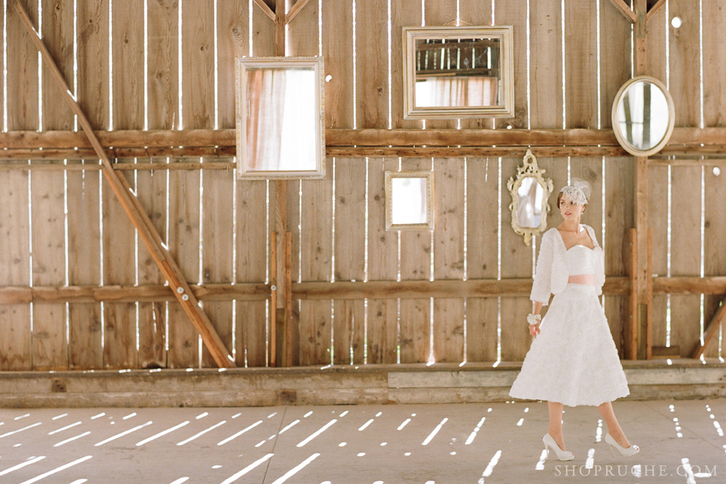 Bridal-separates-from-ruche-with-a-rustic-barn-backdrop.full