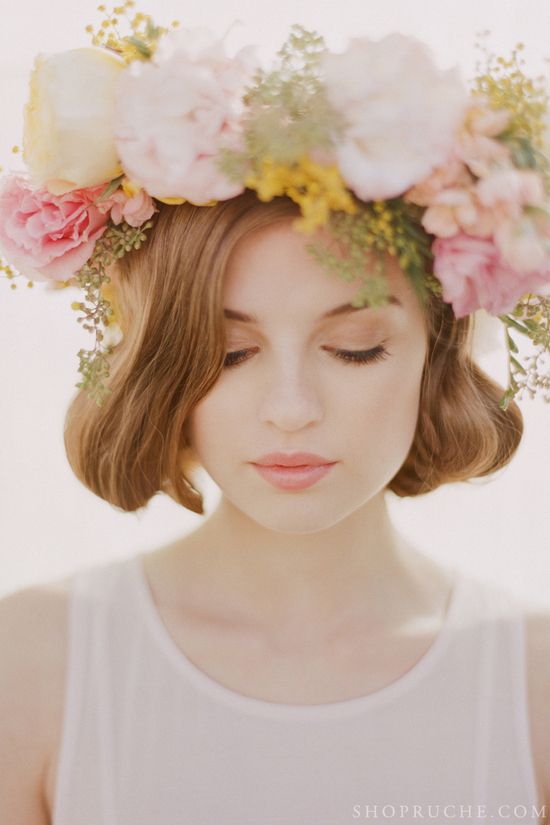 Natural wedding makeup with a floral crown