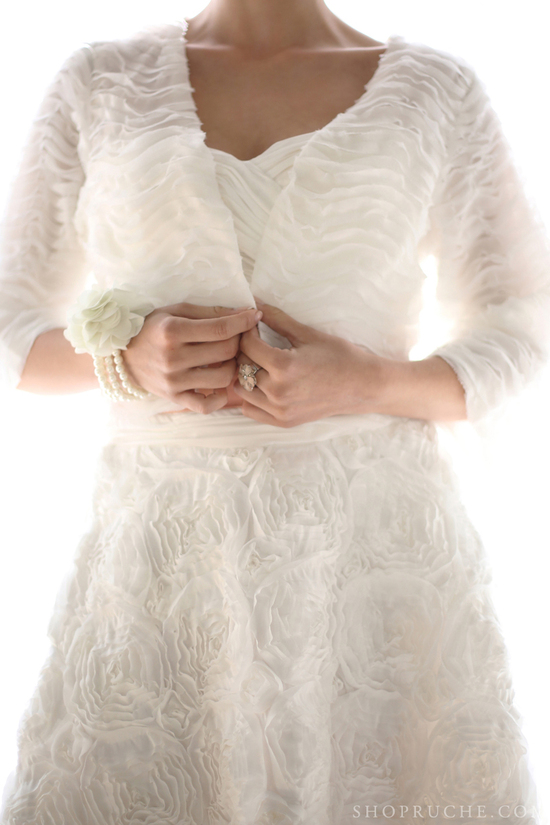 Texture rich bridal bolero and wedding gown