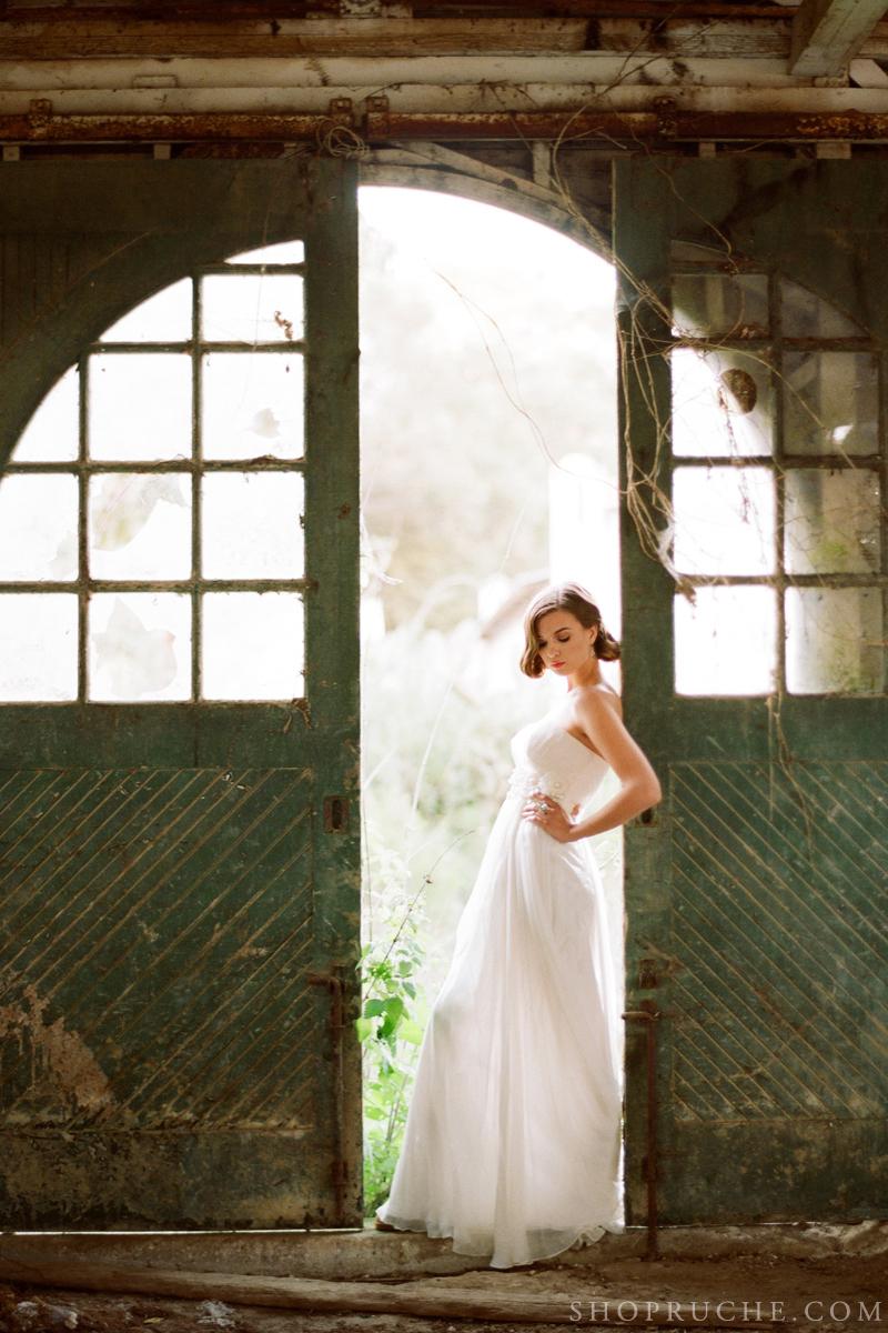 Romantic-bride-poses-in-rustic-barn.full