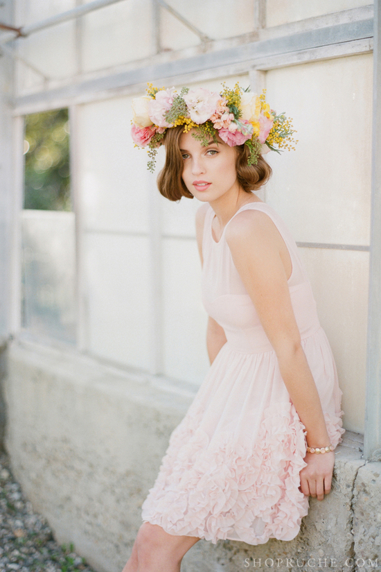 Bridesmaid wears light pink dress and floral crown