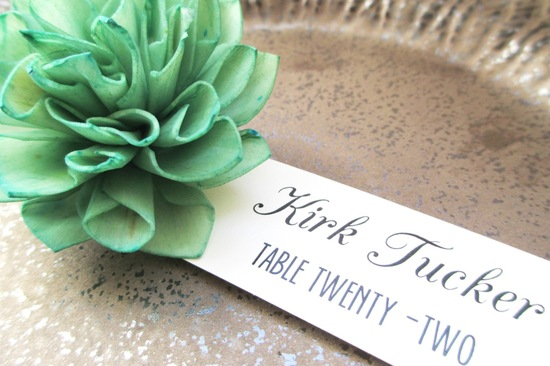 Mint green bloom holds wedding place card