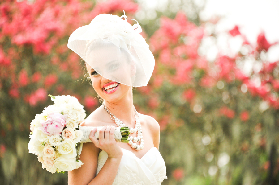 Vintage-bride-shows-off-statement-necklace-and-veil.full