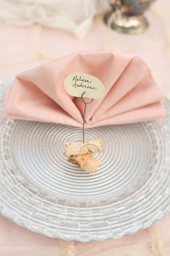 Wine cork wedding escort card holders with pink napkins