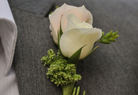Simple rose boutonniere for groom