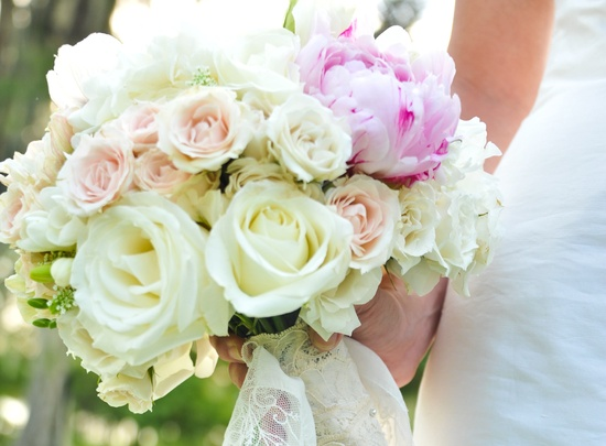 Ivory roses and pink peonies wedding bouquet with lace wrap
