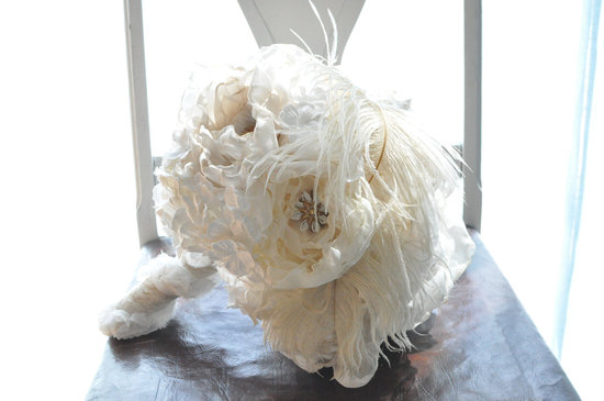 Ivory peony hydrangea and feather wedding bouquet