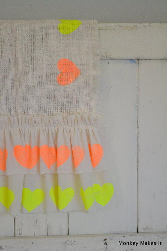 Rustic burlap wedding table runner with neon hearts