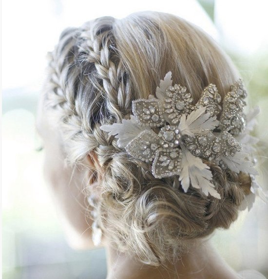 Double braid wedding hairstyle finished with a beaded fascinator