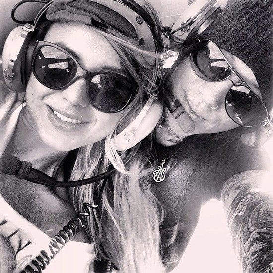 photo of Celebrity Engagements - Guns N' Roses guitarist DJ Ashba pops the question on a helicopter