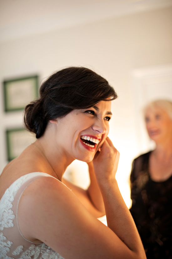 Florida bride laughs while getting ready for her ceremony