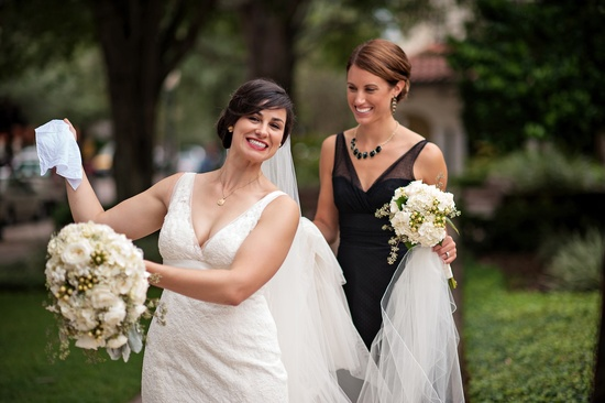 Vintage bride poses with classic bridesmaids in black
