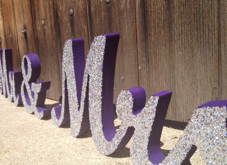 Purple with silver glitter wedding sign spelling Mr and Mrs