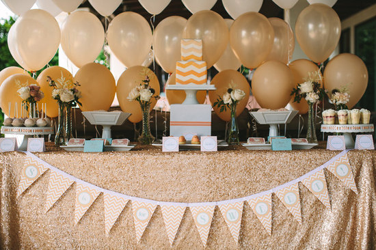 Glittery gold linens for wedding dessert bar
