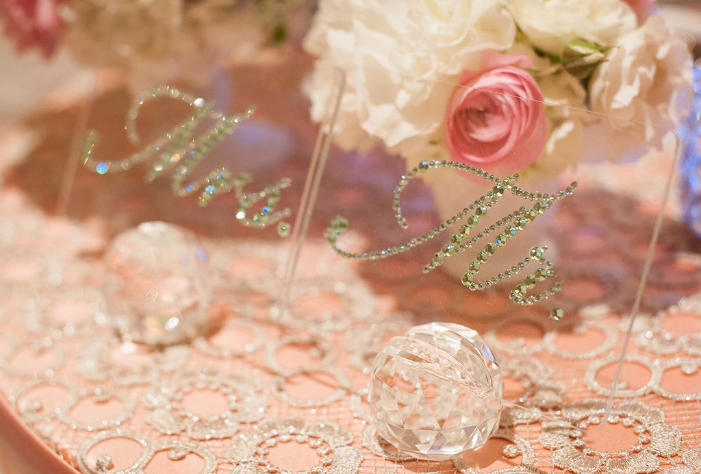 Plexiglass wedding table signs for the bride and groom