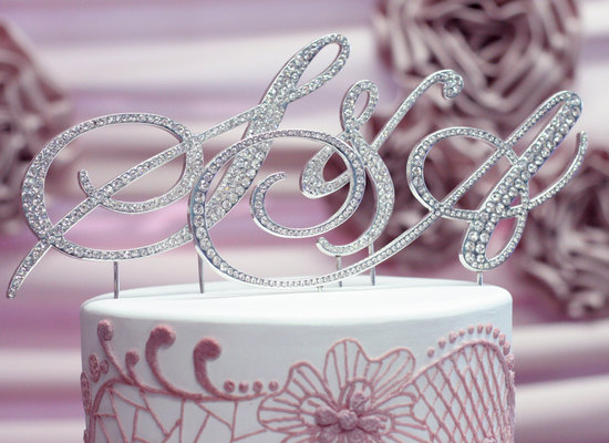 Silver crystal monogram wedding cake topper