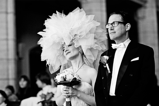 Bride wears larger than life wedding headpiece