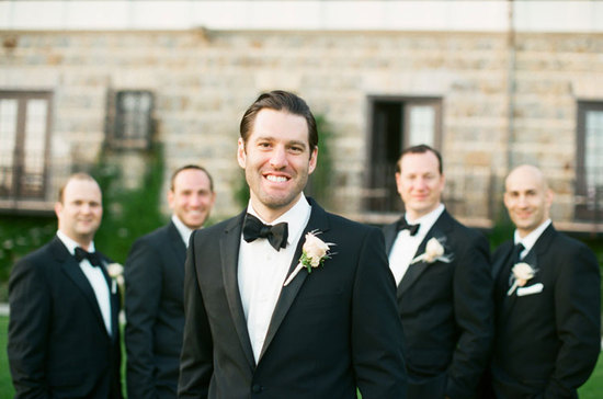 Classic black tie groom with groomsmen