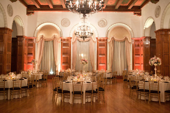Elegant wedding reception venue featuring chandeliers and draping