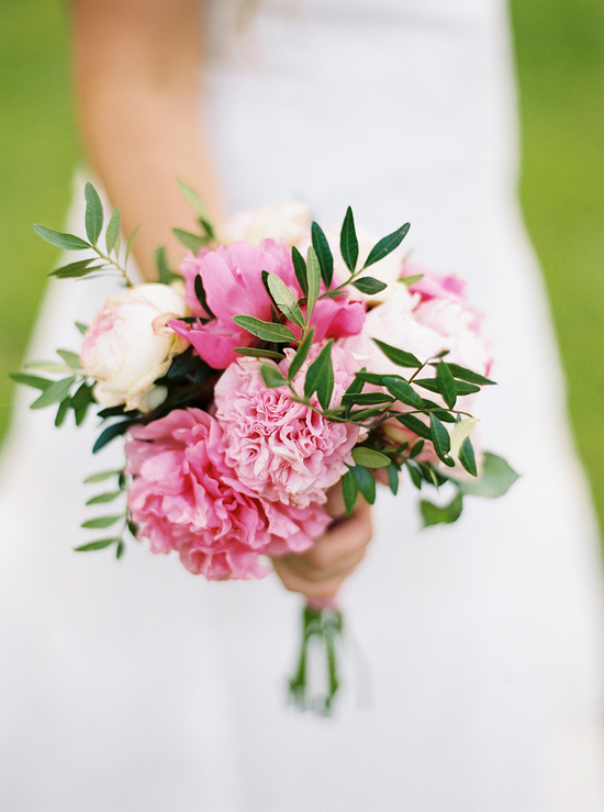 Simple pink peony wedding bouquet with green leaves