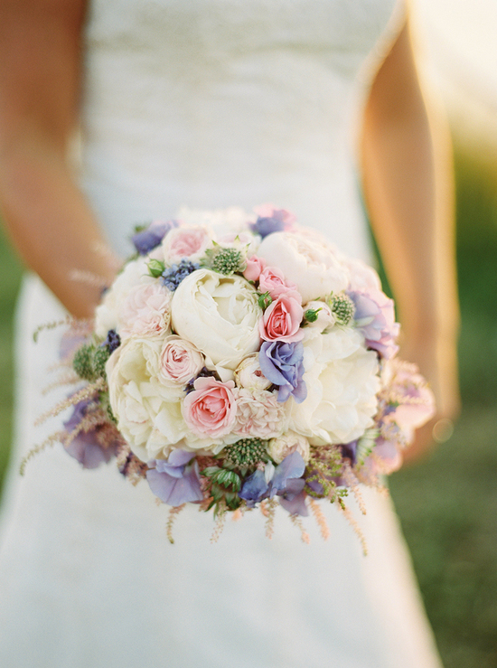photo of Ivory pale pink and purple romantic wedding bouquet