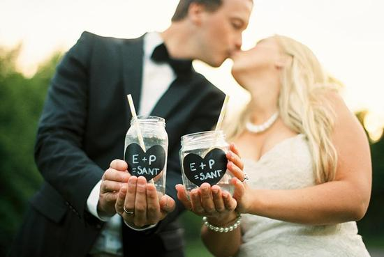 Black tie bride and groom add rustic touches with mason jars