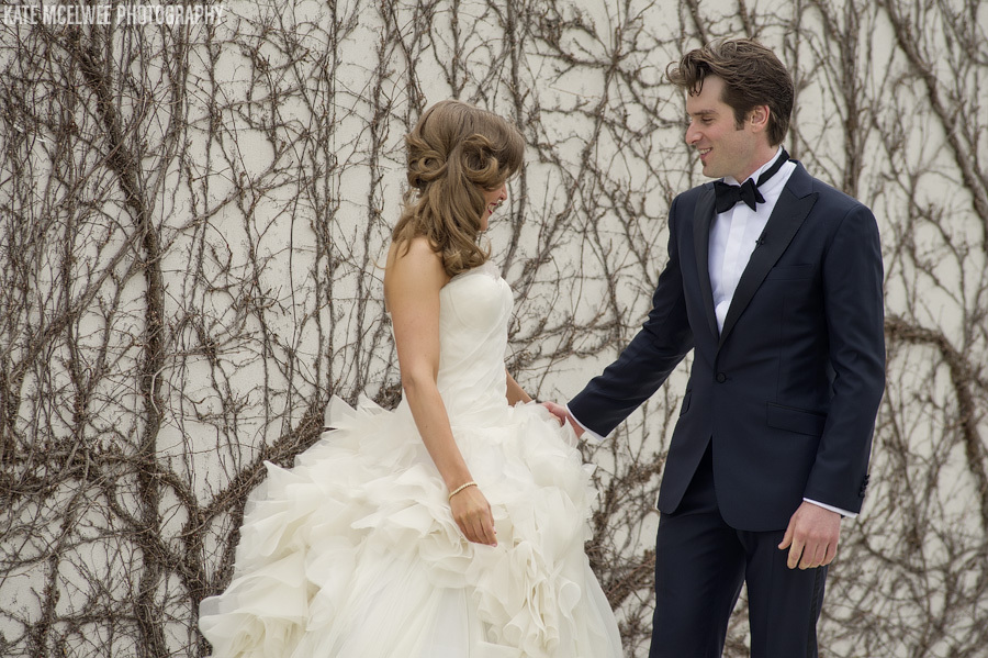 Stunning-bride-wears-vintage-inspired-half-up-hairstyle-shares-first-look-with-groom.full