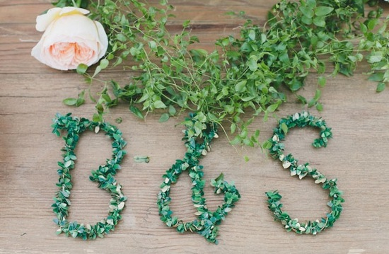 Wedding monogram spelled out in leaves