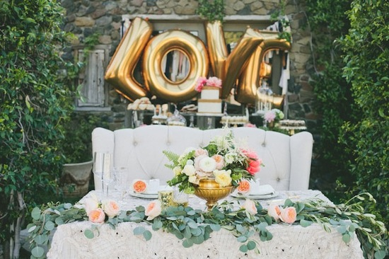 whimsical wedding desert bar with gold Love balloons
