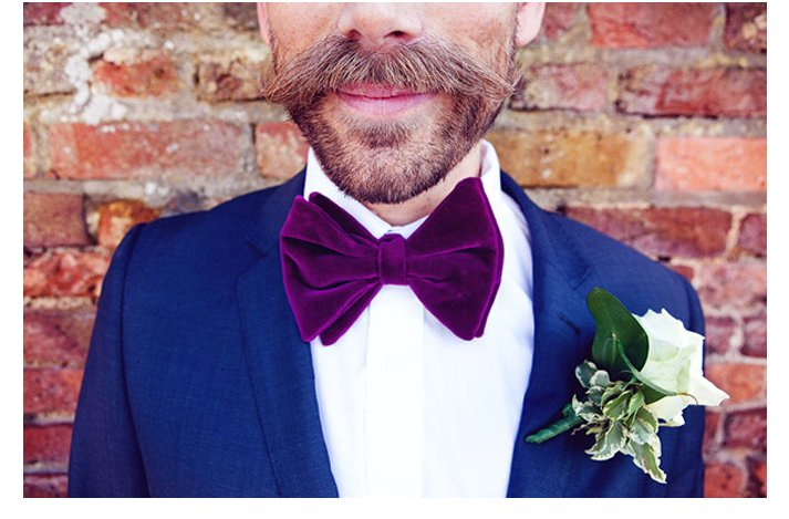 Quirky yet dapper grooms' wearing bow ties- jewel tones and a top hat