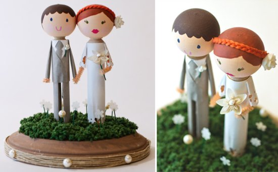 Cute handmade wedding cake topper of bride and groom