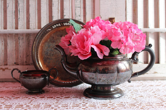 vintage pewter tea pot with bright pink peony flowers