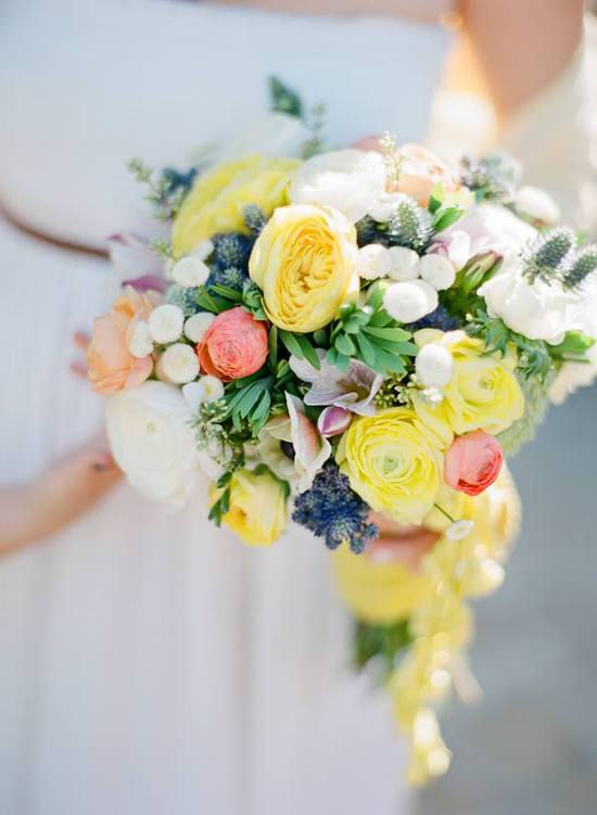 Gorgeous wedding bouquet in yellow ivory green coral and peach