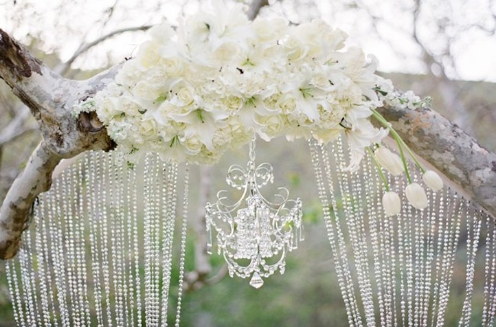 Glamping-wedding-style-floral-crystal-adorned-arbor.full