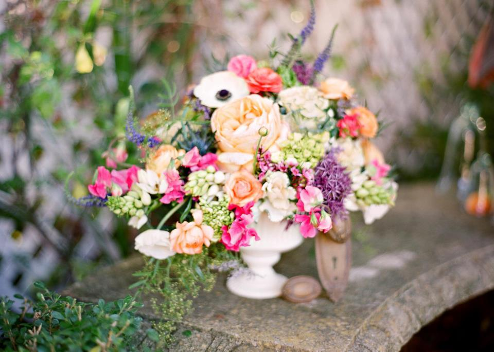 Romantic garden wedding centerpiece with anemones roses and more