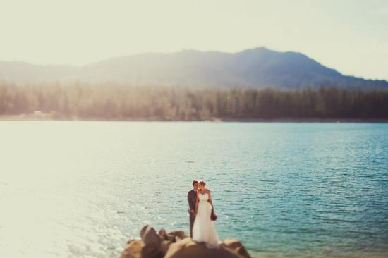 Gorgeous wedding couples photo with serene natural backdrop